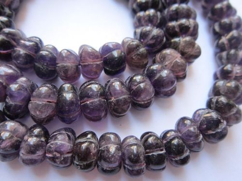 amthyst carved roundell beads single strand 13 inch 10mm