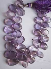 amethyst plain almond  beads single strand 7 inch