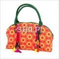 Floral Printed Boat bag with Green Kantha Handle and Multi Color Tassles