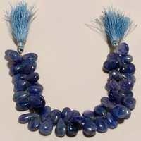 7 inch tanzanite plain almond beads 310 cts 10x15mm to 10x13mm to 10x14mm 45 pcs