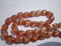 7 inch  hassonite zircon 4x6mm faceted oval beads one strand
