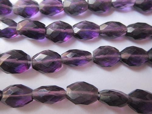 13inch. African amethyst  faceted oval beads 9x11mm to 10x12mm