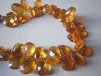 Citrine faceted almond beads one strand7 inch 9x12mm to 7x10mm