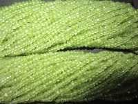 13 inch peridot 2mm -3mm faceted Roundell  beads one strand