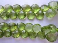 Peridot faceted small almond 8 inch one strand beads 7mm 55 pcs.