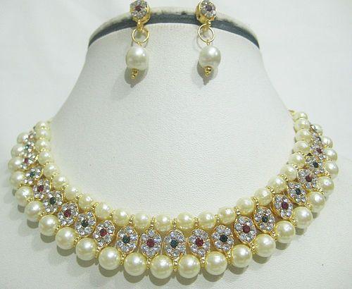 stone studded pearl earrings