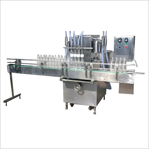 AUTOMATIC FOUR HEAD LIQUID FILLING MACHINE