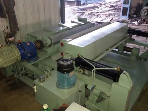 Log rounder machine