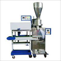 Vertical Pouch Sealer with Volumetric Cup Filler