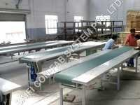 Conveyor With Working Table