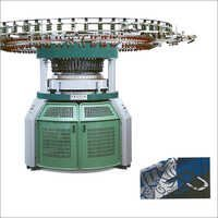 Double Computerized Stripper & Jacquard Knitting Machine