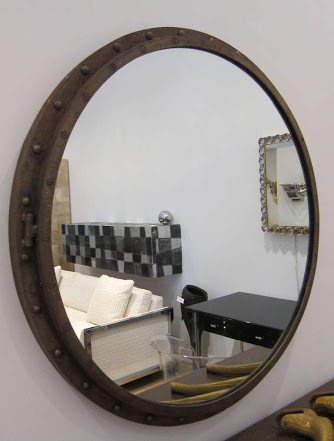 Antique brown shaded brass porthole mirror