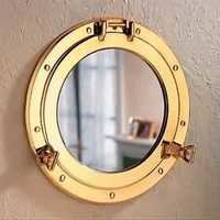 Antique gold shaded brass porthole mirror