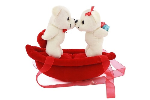 KISSING TEDDY ON BOAT