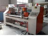 SEMI AUTO DOUBLE HEAD STITCHING MACHINE