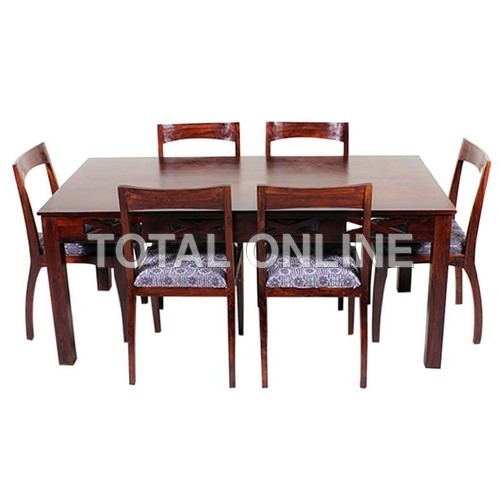 Sober Looking Dining Table With Six Padded Chairs