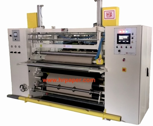 Shaft Less Slitting & Rewinding Machine for making Plotter Paper Rolls.