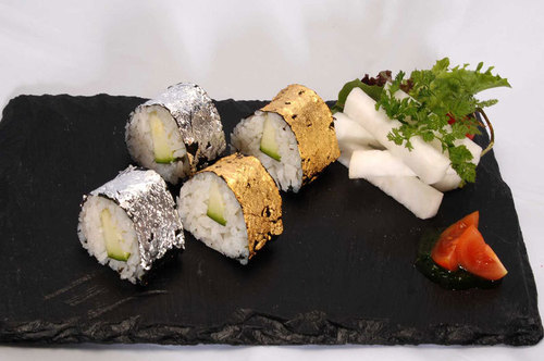 Sushi rolls decorated with silver & gold warq