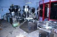 Auger Bottle Filler Line