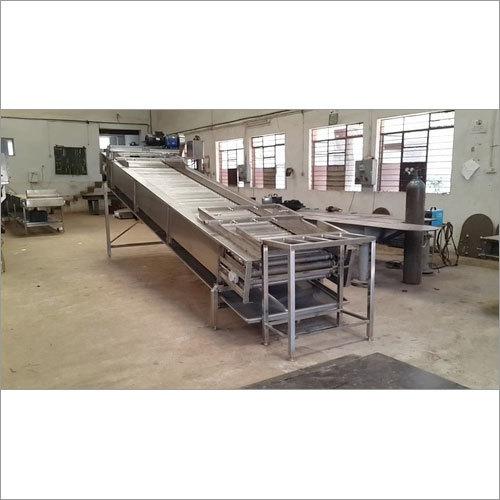 Mango Loading roller conveyor and washer