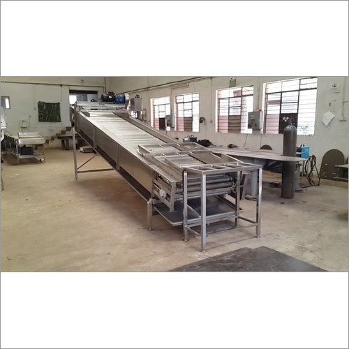 Mango Loading roller conveyor and washer