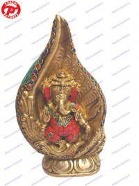 Ganesh Sitting In Shankh W/Lotus Base