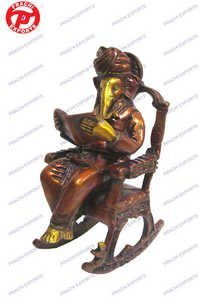 Ganesh Reading Book On Chair