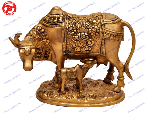 Cow Standing With Calf On Oval Base