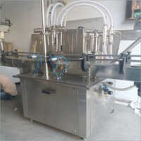 Automatic Four Head Bottle Filling Machine