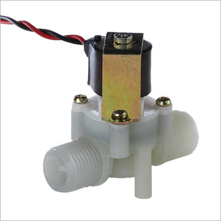 Normally closed and magnetically latching solenoid