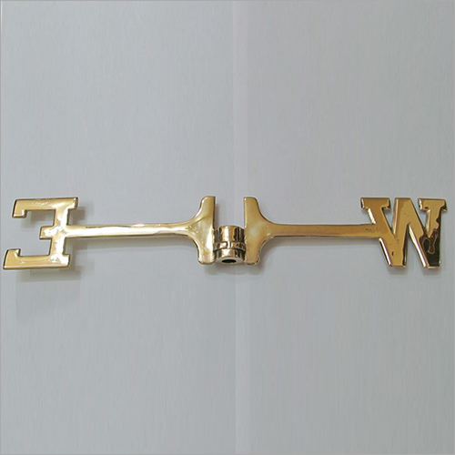 Metal East West Sign
