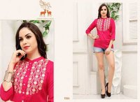SHORT TOPS WITH EMBROIDARY