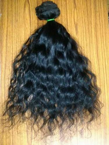 REMY WEFT CURLY EXTENSIONS