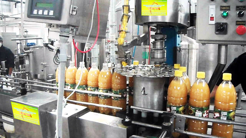 AUTOMATIC JUICE FILLING CAPPING MACHINE