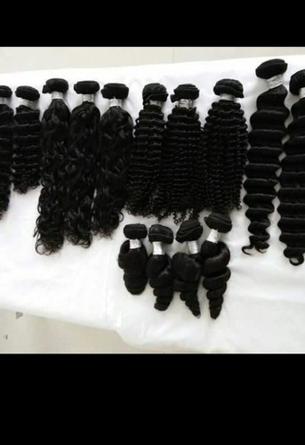 STYLED OR TEXTURED HUMAN HAIR