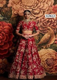 Red Bridal Lehenga choli with heavy lace work on dupatta