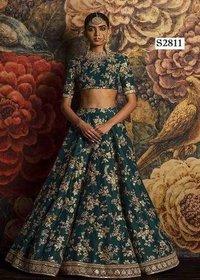 Dark rama green Bridal Lehenga choli with heavy lace work on dupatta