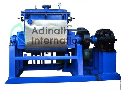 Extruding discharge sigma blade mixer for silicone