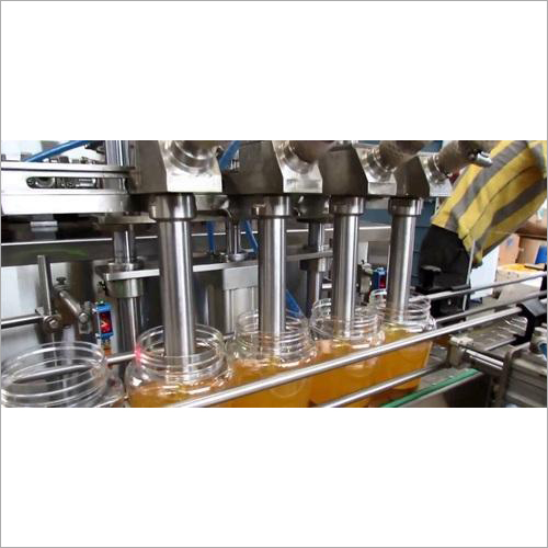 Ghee Bottle And Jar Filling And Capping Machine