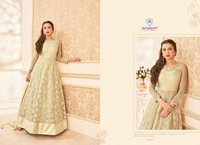Golden party wear designer dress material