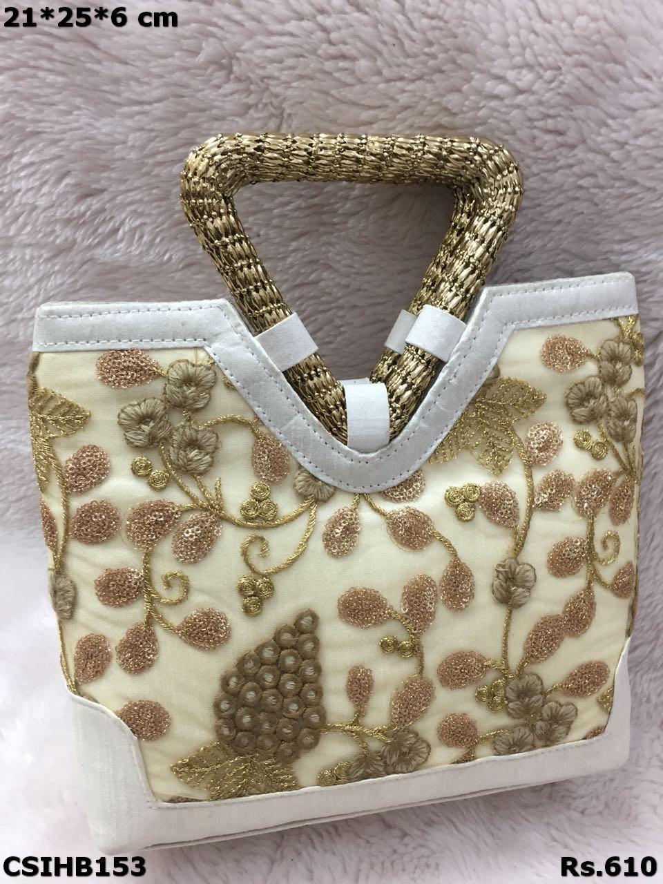 Triangle handle handbag