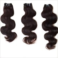 Processed body wave hair