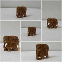 sandal wood carving elephent