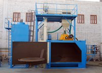 aSwing Table Type Shot Blasting Machine