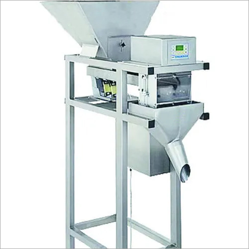 WEIGHING BASE FILLING MACHINE