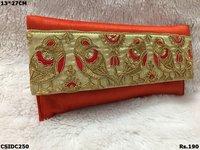 parrot design silk clutch