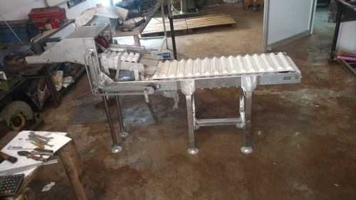 Conveyors and Roller Chain Assembly