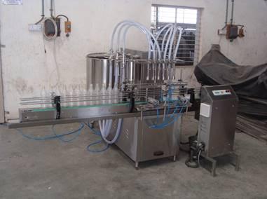 Four Head Volumetric Liquid Bottle Filling Machine