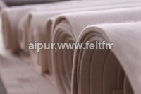 Woolen compressed felts