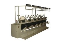 Automatic cheese winding machine